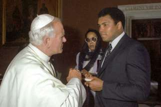 Pope John Paul II meets with Muhammad Ali in 1982 at the Vatican. Ali got his start working at a Louisville Catholic college. He died June 3 at age 74 after a long battle with Parkinson's.