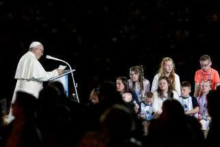 Pope Francis speaks to families during the Festival of Families in Croke Park stadium in Dublin Aug. 25.