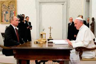 Pope Francis meets with Russian President Vladimir Putin during a private audience at the Vatican Nov. 25, 2013.