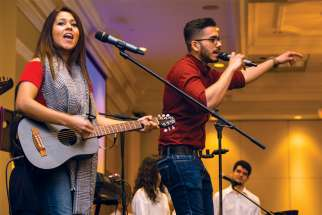 Whitney D'Cunha on guitar and Shaun Fernandes demand a response from Catholic high school students from across the GTA at the Serra Club's March 5 Ordinandi Youth Event.