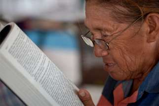A woman reads the Bible Sept. 5, 2019, in St. Ignatius, Guyana.