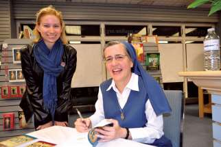 Sr. Marie Paul Curley, at top signing one of her previous books, has just released Soul of Christ: Meditations on a Timeless Prayer.