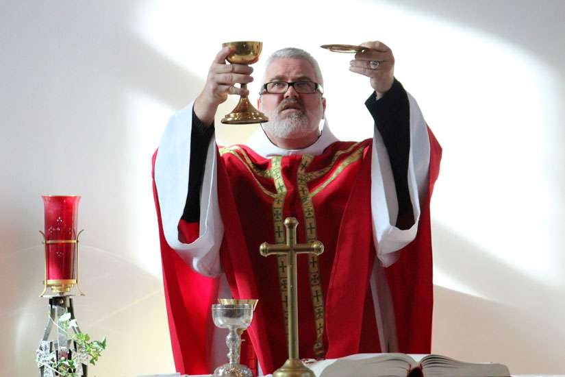 Bishop-elect Scott McCaig celebrates Mass at the St. Therese School.