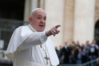 Pope Francis gestures as he arrives to lead his general audience in St. Peter's Square at the Vatican Feb. 26, 2020.