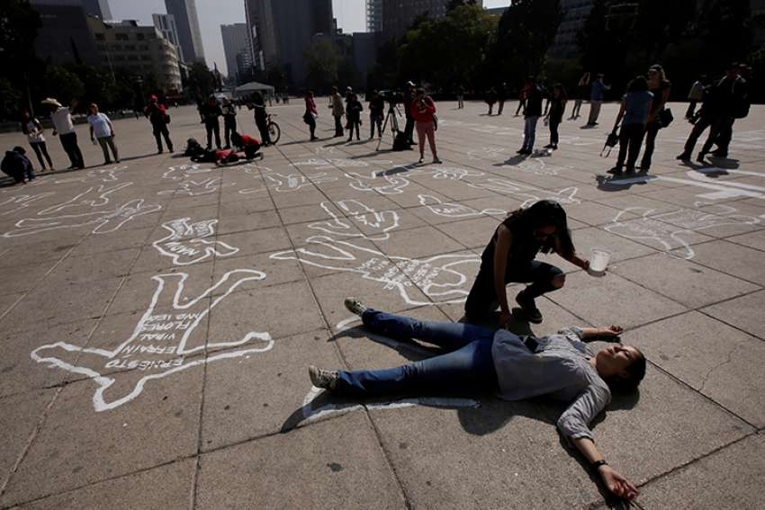 Demonstrators at the Monument to the Revolution in Mexico City demand justice for victims of violence Dec. 11, 2016. The majority of Catholic Church workers violently killed in 2017 were victims of attempted robberies, the Vatican's Fides agency said, with Nigeria and Mexico topping the list countries where the most brutal murders were carried out.