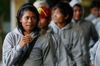 Trafficked Cambodian fishermen arrive in 2013 at Phnom Penh International Airport in Cambodia. The 30 trafficked Cambodian fishermen returned home from Indonesia with help from Indonesian authorities and International Organization for Migration.
