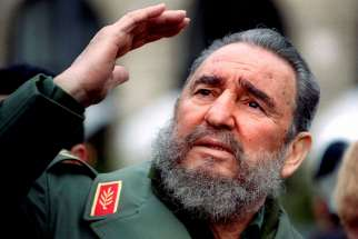 Cuba's President Fidel Castro gestures during a tour of Paris in this March 15, 1995 file photo. Castro passed away on Nov. 25 at the age of 90.
