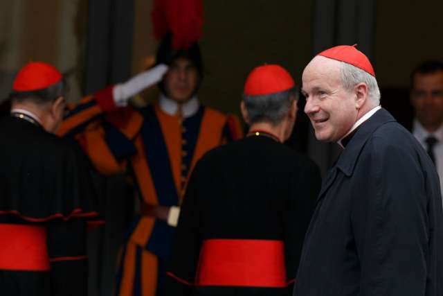 Cardinal Christoph Schonborn of Vienna, right, arrives for the afternoon session of the general congregation meeting in the synod hall at the Vatican March 8.