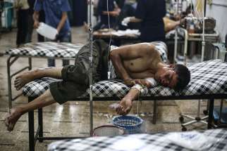A young Syrian man receives medical treatment July 21 at a field hospital in the region of Douma in Damascus, Syria.