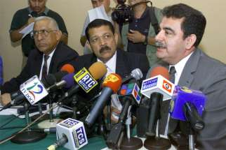 Salvadoran Gen. Rene Emilio Ponce, right, and his colleagues, Colonels Francisco Elena Fuentes, left, and Inocente Orlando Montano, center, are pictured in a 2000 photo during a news conference denying involvement in the 1989 deaths of six Jesuit priests, their housekeeper and her daughter.