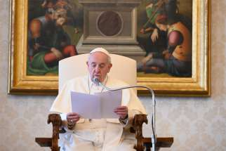 Pope Francis speaks during his general audience as it is livestreamed from the library of the Apostolic Palace at the Vatican April 1, 2020.