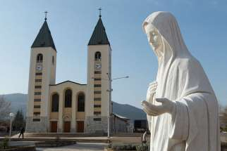 A statue of Mary is seen outside St. James Church in Medjugorje, Bosnia-Herzegovina, in this Feb. 26, 2011, file photo. The local bishop says again that the Virgin Mary has not appeared in Medjugorje.