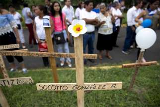 People in Managua, Nicaragua, pay tribute Oct. 28 to those who lost their lives in protest against President Daniel Ortega.
