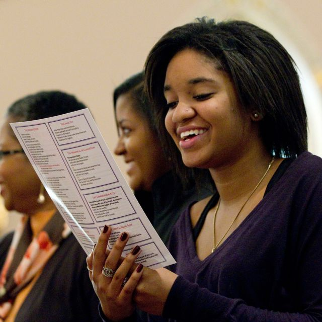 Alyssa Brooks recites a newly worded response during Mass at St. Joseph's Catholic Church in Virginia.