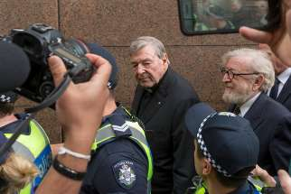 Australian Cardinal George Pell is seen after leaving the Melbourne Magistrates' Court in Australia July 26, 2017.