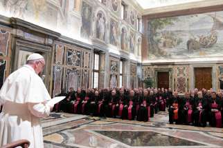 Pope Francis speaks during a meeting with nuncios, who represent the pope around the world, in the Apostolic Palace at the Vatican Sept. 17.