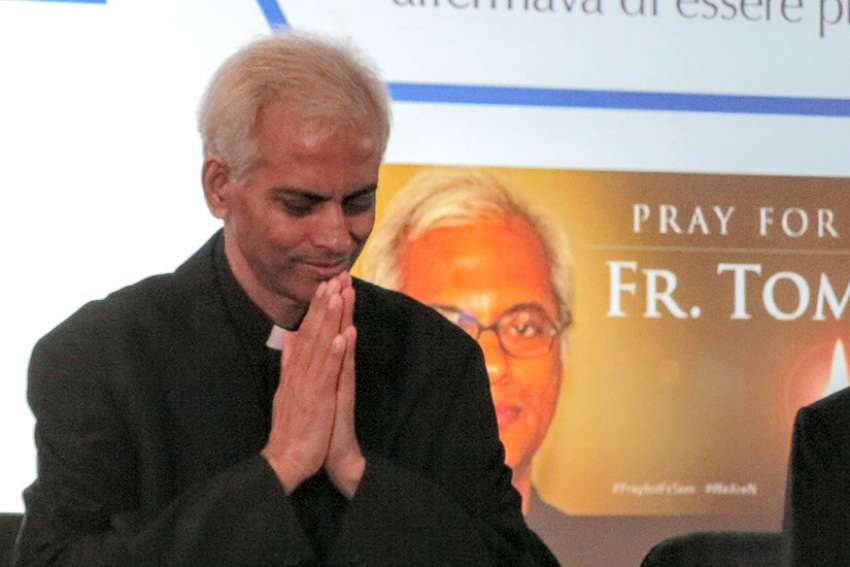 Salesian Father Tom Uzhunnalil, who was released from captivity Sept. 12, greets journalists as he arrives for a news conference in Rome Sept. 16. Father Uzhunnalil was abducted during an attack on a charity care home in Yemen in March 2016 and imprisoned for 18 months.