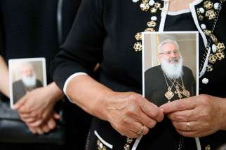 A woman holds an image of Ukrainian Cardinal Lubomyr Husar during his June 5 funeral Mass at the Patriarchal Cathedral of the Resurrection of Christ in Kiev. Cardinal Husar died May 31 at the age of 84.