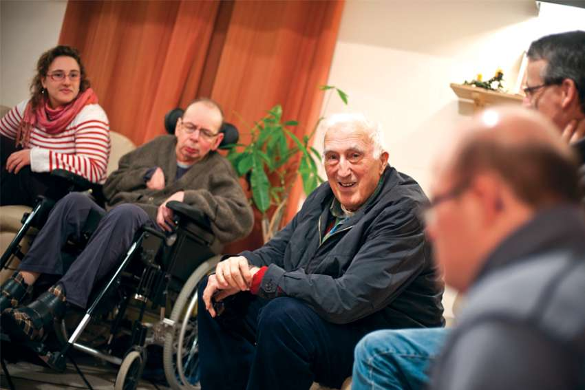 Jean Vanier is pictured during a visit with members of the L'Arche coummunity in March 2011.