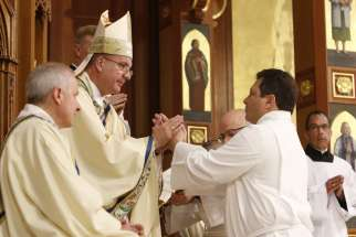 Ivan Toro makes his promise of obedience to Bishop John O. Barres of Rockville Centre, N.Y., during his ordination to the permanent diaconate June 1, 2019, at St. Agnes Cathedral in Rockville Centre.