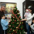 The Musallam family puts final touches on a Christmas tree at their apartment in the West Bank city of Bethlehem Dec. 15. Christmastime for Christians in the Holy Land is family time -- with many attending services, presenting gifts, visiting friends and sharing traditional treats. Pictured with Rami Musallam and his wife, Loreen, are 8-year-old Ameer, 4-month-old Sarah, and Aram, 5.