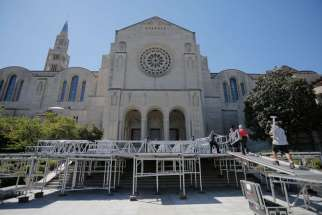 Workers assemble a stage Sept. 14 where Pope Francis will celebrate Mass outside the Basilica of the National Shrine of the Immaculate Conception in Washington Sept. 23.