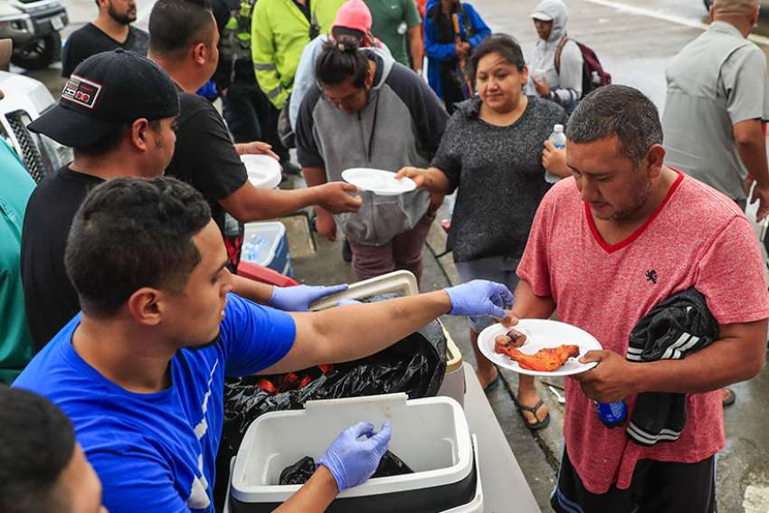 Evacuees are given a meal Aug. 29 after being rescued from their neighborhoods in the aftermath of Tropical Storm Harvey in Houston.