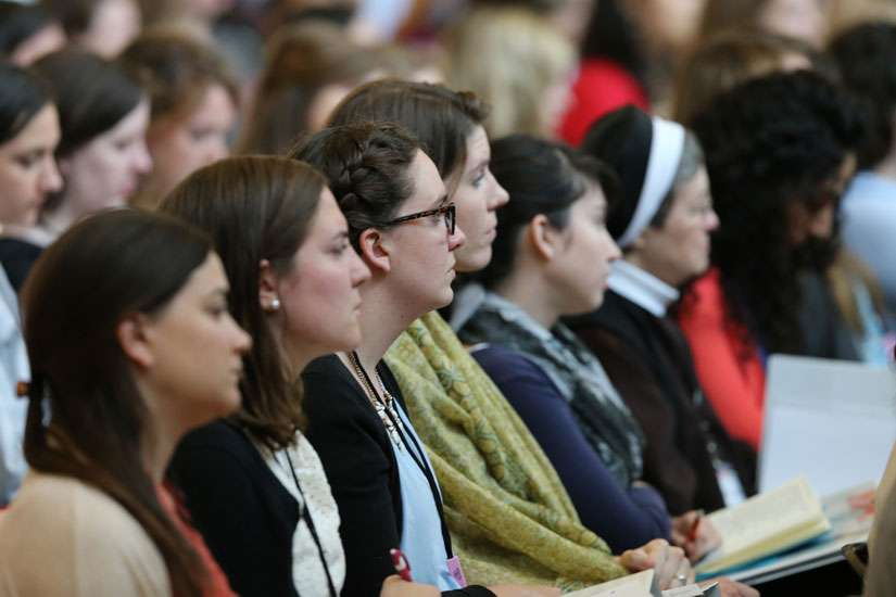 Women listen to a keynote speaker at a young Catholic women leadership forum in Arlington, Va. June 8. The Congregation for the Doctrine of the Faith held a symposium at the Vatican Sept. 26-28 discussing the role of women in the Catholic Church.