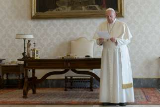 Pope Francis leads a global recitation of the Lord's Prayer from the library of the Apostolic Palace at the Vatican March 25, 2020. The pope and the Orthodox, Anglican and Protestant leaders who joined him for the prayer implored God's mercy on humanity amid the coronavirus pandemic.