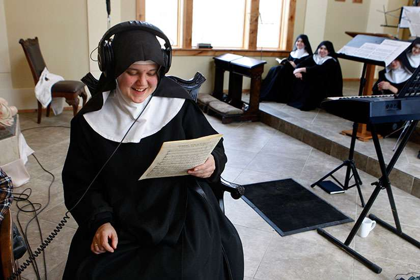 "Mother Cecilia listens back to a recording while the singing nuns take a break, on February 18, 2016. The Benedictines of Mary, Queen of Apostles, are cloistered nuns who have had four albums top the charts. They released their latest album, ""Adoration at Ephesus,"" on April 26, 2016."
