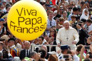 A large ballon is seen as Pope Francis greets the crowd during his general audience in St. Peter's Square at the Vatican June 13.