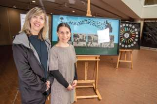 Art teacher Donna Sistilli, left, and English teacher Rita Sarra Macchios with some of the artwork that is part of the exhibition on Indigenous themes by adult students at Toronto's Msgr. Fraser College. The teachers are part of the team in the Native Studies program at the school.