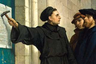 Martin Luther posts his 95 theses in Wittenburg in this painting by Ferdinand Pauwels.