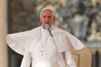 Pope Francis leads his general audience in St. Peter's Square at the Vatican Oct. 14.