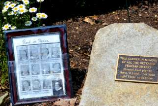 A small memorial for the 12 sisters who died in one month from COVID-19 sits in the garden outside the Felician sisters' convent in Livonia, Mich., June 10, 2020.