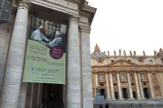 "A banner over the entrance to the Vatican's Braccio Di Carlo Magno hall announces the opening of the exhibit, ""A Blessing to One Another: Pope John Paul II and the Jewish People."""