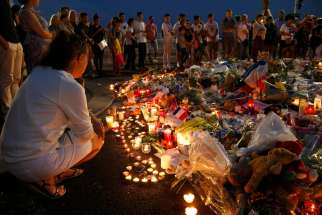 People gather around flowers and burning candles July 17 to pay tribute to victims of the Bastille Day attack in Nice, France. France and Germany are facing challenges of radicalized Muslim youths in their own country.