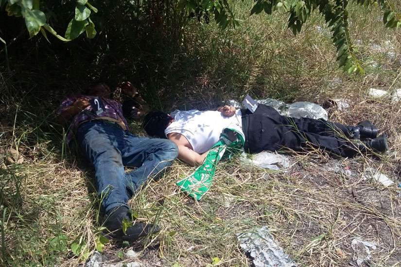 The bodies of Fathers Alejo Nabor Jimenez Juarez and Jose Alfredo Juarez de la Cruz are seen along a roadside Sept. 19 in the Mexican state of Veracruz. The priests were found murdered that day, just hours after they were kidnapped from the low-income neighborhood where they served.