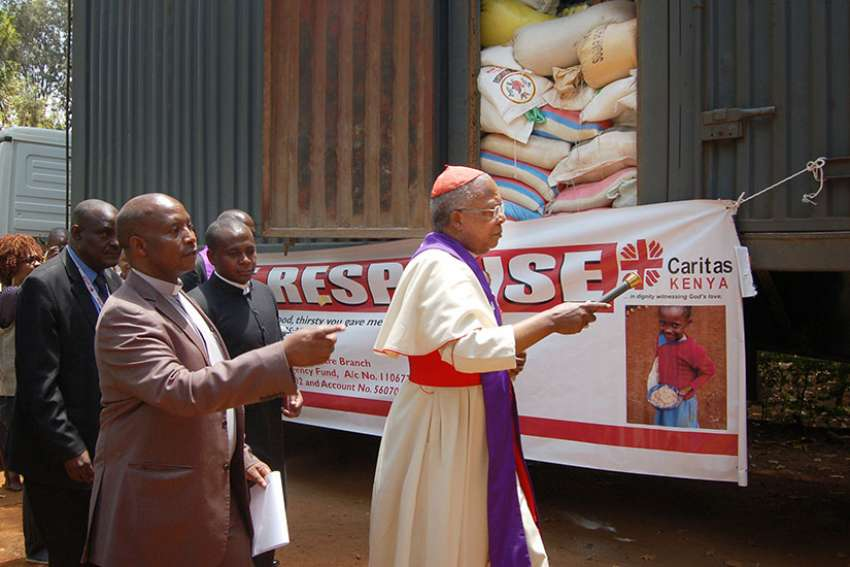 Cardinal John Njue of Nairobi, Kenya, blesses food aid March 17 that was being delivered to Isiolo and Marsabit, two dioceses affected by the drought.