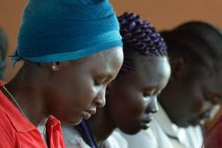 Students pray during an assembly May 1 at the Solidarity Teacher Training College in Yambio, South Sudan.