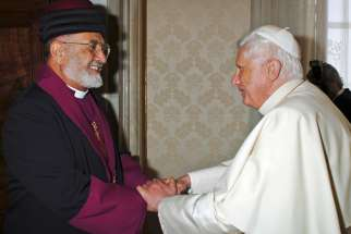 Catholicos Dinkha IV, patriarch of the Assyrian Church of the East, is greeted by Pope Benedict XVI in 2007. Patriarch Dinkha died March 26 at the Mayo Clinic in Rochester, Minn. A virus infection and pneumonia were cited as the cause of death; he was 79.