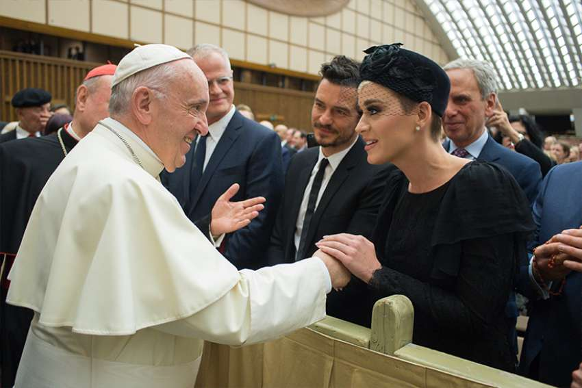 "Pope Francis greets singer Katy Perry, accompanied by English actor Orlando Bloom, during an audience with people participating in the ""United to Cure Conference"" at the Vatican April 28. Hundreds of physicians, researchers and health care executives attended the April 26-28 conference to talk about medical advances and steps to promote health-care around the world."