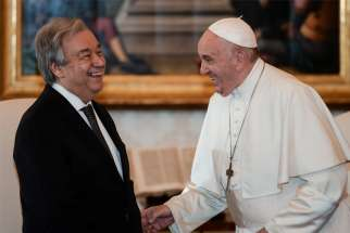 Pope Francis shares a light moment with U.N. Secretary-General Antonio Guterres during a private audience at the Vatican Dec. 20, 2019.