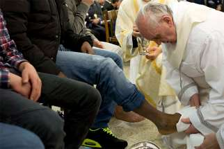 Pope Francis washes the foot of an inmate during the Holy Thursday Mass at Casal del Marmo prison for minors in Rome in this March 28, 2013, file photo. Pope Francis will celebrate Mass March 29 at Rome's Regina Coeli prison and wash the feet of 12 inmates.