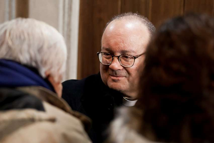 Archbishop Charles Scicluna of Malta speaks with members of the Catholic community inside a church in Osorno, Chile, June 14.