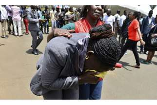 A Red Cross worker comforts a mourner as bodies of the students killed in a Thursday (April 2) attack, arrive at the Chiromo Mortuary in Nairobi. At least 147 people died in an assault by Somali militants on a Kenyan university, as anger grew among local residents over what they say was a government failure to prevent bloodshed.
