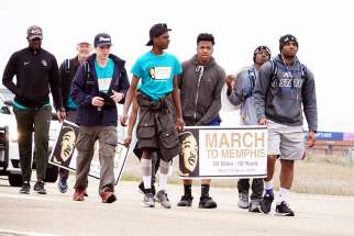 "A group of teenagers from Pearl, Miss., walk along U.S. Highway 61 just south of Memphis, Tenn., April 2, on their 50-mile ""March to Memphis"" tribute to the Rev. Martin Luther King Jr. April 2. April 4 marks the 50th anniversary of the death of the civil rights leader in Memphis."