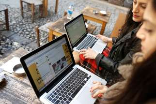 Turkish women try to connect to Twitter at a cafe in Istanbul, Turkey.