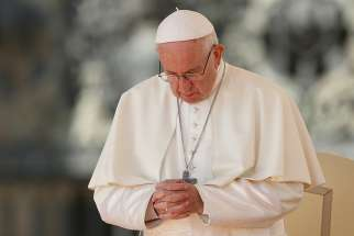 Pope Francis prays during his general audience in St. Peter's Square at the Vatican Oct. 10.
