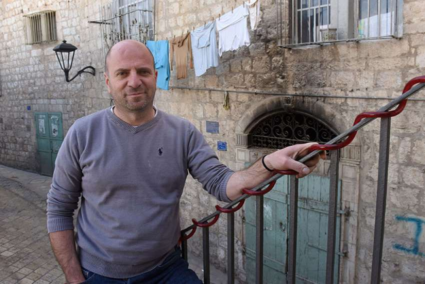 Palestinian Christian Sami Awad, founder and executive director of the Holy Land Trust, poses outside his office Feb. 27 in Bethlehem.